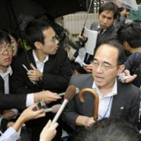 Relieved: A Fujita Corp. spokesman fields questions Thursday outside company headquarters in Tokyo after three of its four employees were released in China. | KYODO PHOTO