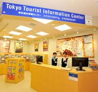 Questions?: Tourist information center staff at Haneda's new international terminal participate in a media preview Oct. 7. Services will be provided in Japanese, English, Chinese and Korean. | YOSHIAKI MIURA PHOTO