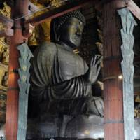 They were always there: Visitors view the Great Buddha in Nara's Todaiji Temple on Monday. Two swords (below) found under the statue have been identified as sacred ones unaccounted for for some 1,250 years. | KYODO PHOTO