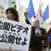Public showing: Protesters pushing for the government to release footage of the collision between a Chinese fishing boat and Japan Coast Guard vessels march in the streets of Tokyo's Ginza district Saturday. | KYODO PHOTO