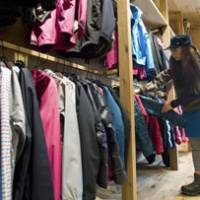 Mountain minis: Minako Yoshikoshi, an employee at Goldwin Inc.'s North Face Harajuku store in Tokyo, arranges trekking wear popular with women in their 20s and 30s, on Nov. 2. | BLOOMBERG PHOTO