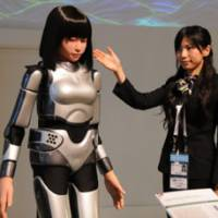 Karaoke pal: Humanoid robot HRP-4C Miim, which can sing and dance, is introduced to journalists Wednesday at the International Media Center at the APEC conference venue in Yokohama. | SATOKO KAWASAKI PHOTO