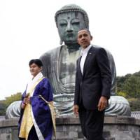 U.S. President Barack Obama walks Sunday with Takao Sato, the 15th chief monk of the Kotokuin Temple in Kamakura. | AP PHOTO