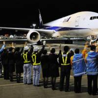 Maiden flight: All Nippon Airways Co. staff see off the airline's first international flight from Tokyo's Haneda airport on Oct. 30. | KYODO PHOTO