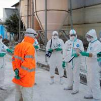 Mission complete: Workers in protective suits go through a checklist of bird-flu countermeasures Sunday at a poultry farm in Yasugi, Shimane Prefecture. | COURTESY OF SHIMANE PREFECTURAL GOVERNMENT