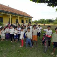 Building lives: Kids stand in front of Damrei Krom Primary School, built by AMATAK in Banteaymeanchey Province, Cambodia, in this Aug. 26 photo. | COURTESY OF AMATAK HOUSE OF CAMBODIA