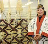 Proud heritage: Shizue Ukaji, a 77-year-old Ainu living in the Tokyo area, poses during an interview at the Ainu Culture Center, Tokyo, in Chuo Ward on Dec. 8. | SATOKO KAWASAKI PHOTO