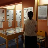 Cold comfort: A visitor at the Women's Active Museum on War and Peace in Shinjuku Ward, Tokyo, looks at an exhibit on Taiwanese women who were sexually exploited by the Japanese military. | KYODO