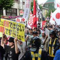 Racial intolerance: People demonstrate against ethnic Korean residents in June in the bustling Shin-Okubo district in Shinjuku Ward, Tokyo, an enclave more commonly known as Koreatown. | KYODO