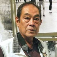 Okinawan chronicler: Hiroaki Yamashiro, 64, is exhibiting his photographs at the Japan Newspaper Museum in Yokohama. | KYODO