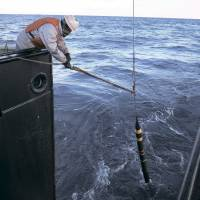 Deep dip: Researchers drop a spectrometer into the sea near Sendai Bay to measure suboceanic concentrations of cesium-137. | COURTESY OF UNIVERSITY OF TOKYO INSTITUTE OF INDUSTRIAL SCIENCE/NATIONAL MARITIME RESEARCH INSTITUTE
