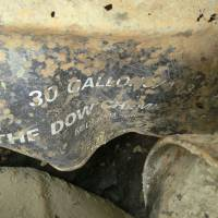 Branded: One of the 22 barrels dug up in the city of Okinawa bears the mark of Dow Chemical Co., a leading manufacturer of military defoliants during the Vietnam War. | JON MITCHELL