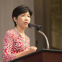 Spelling it out: Kathy Matsui, managing director and chief Japan equity strategist for Goldman Sachs Japan Co., speaks at the 18th International Conference for Women in Business on Sunday in Tokyo. | COURTESY OF EWOMAN INC.