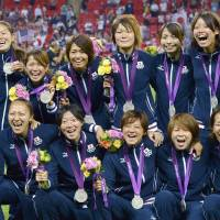 Upgraded: Members of Nadeshiko Japan celebrate their silver medal at the 2012 Olympics. | KYODO