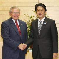 Crucial bond: Prime Minister Shinzo Abe welcomes Robert Menendez, the chairman of the U.S. Senate Foreign Relations Committee, at his office in Tokyo Thursday. | KYODO
