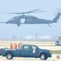 Back up: A U.S. Air Force HH-60G helicopter takes off Friday from the Kadena Air Base in Okinawa. | KYODO