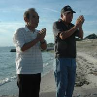 Remembrance: Mitsuhiro Morita (left) and Sueo Kishida pray for the victims of a September 1945 bomb blast in the Otani district of  Tokoname, Aichi Prefecture. | CHUNICHI SHIMBUN