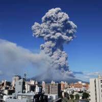 Pyroclastic: Smoke billows from Mount Sakurajima near the city of Kagoshima during an eruption Sunday. | KAGOSHIMA LOCAL METEOROLOGICAL OBSERVATORY/AP