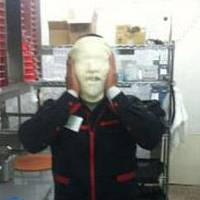 Hand-tossed: A Twitter image shows a part-time worker at a Pizza Hut plastering pizza dough all over his face in May. | KYODO