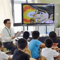 Suddenly taboo: A scene from 'Hadashi no Gen' is shown on a classroom TV at the Motomachi elementary school in Naka Ward, Hiroshima, in June. | KYODO
