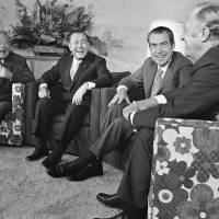 Levity: U.S. President Richard Nixon and Prime Minister Kakuei Tanaka enjoy a laugh with Secretary of State William P. Rogers at the end of a summit in Hawaii on Sept. 1, 1972. | AP