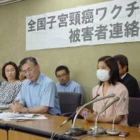 Other side of the story: Members of a support group for people injured by cervical cancer vaccines face reporters Friday in Tokyo after they filed a request for the government to end subsidies for the injections. | KYODO