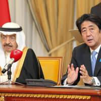 Reopening talks: Prime Minister Shinzo Abe and Prince Khalifa bin Salman Al Khalifa, prime minister of Bahrain, hold a joint press conference in Manama on Saturday. | POOL