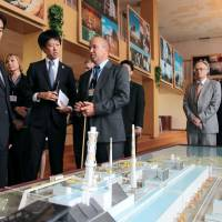 Reality check: Foreign Minister Fumio Kishida (left) is briefed on the status of the Chernobyl nuclear power plant during his visit to Ukraine on Sunday. | KYODO