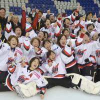 We're in: The Japanese women's ice hockey team celebrates after earning a berth to the 2014 Winter Olympic Games in Sochi, Russia, in the final qualifying round held in Slovakia in February. | KYODO