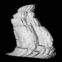 Setting the record straight: A warped 3-D image of a carved face of Buddha is generated from data gathered by an aerial scanner. A computer program is used to correct it. The Buddha's face is one of 173 carved on more than 50 towers at the Bayon temple complex located in the center of Angkor Thom in Cambodia. | COURTESY OF IKEUCHI LABORATORY