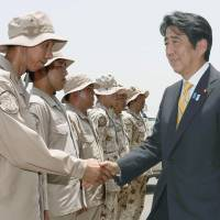 Line of defense: Prime Minister Shinzo Abe thanks Maritime Self-Defense Force personnel engaged in an anti-piracy mission off Somalia at their base in Djibouti on Tuesday. | KYODO