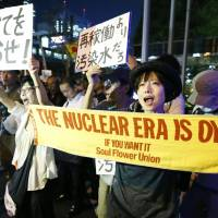 Demonstrators protest in front of Tokyo Electric Power Co.'s head office in central Tokyo Wednesday night against the leakage of radioactive water at the company's Fukushima No. 1 nuclear power plant. | KYODO
