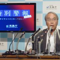 Getting the word out: Meteorological Agency Chief Mitsuhiko Hatori briefs the media about the agency's new alert system Thursday ahead of its launch Friday. | KYODO