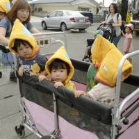 Nursery school students and teachers head to an evacuation area during a disaster drill held in Yamamoto, Miyagi Prefecture, on Saturday. | KYODO