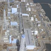 Early days: The Fukushima No. 1 plant is seen on March 24, 2011, as the meltdown crisis triggered by the quake and tsunami 13 days earlier rapidly escalated.    AIR PHOTO SERVICE/AP