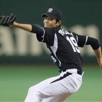 Home from home: Hanshin starting pitcher Shintaro Fujinami delivers in the sixth inning of the Tigers' 7-0 win over the Giants at Tokyo Dome on Sunday. | KYODO