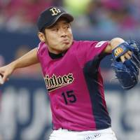 Pretty in pink: Orix's Tatsuya Sato delivers during the Buffaloes' 8-3 win over the Dragons at Kyocera Dome on Saturday. | KYODO