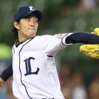 Calm before the storm: Seibu starting pitcher Takayuki Kishi delivers during the Lions' 12-11 win over the Golden Eagles at Seibu Dome on Sunday. | KYODO