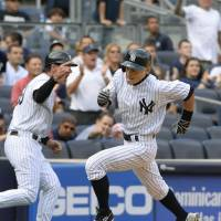 Almost there: New York's Ichiro Suzuki rounds third base on his way home in the seventh inning of the Yankees' 8-4 win over the Blue Jays on Tuesday afternoon. | KYODO