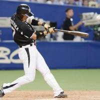 The catalyst: The Tigers' Tsuyoshi Nishioka delivers a go-ahead single in the ninth inning against the Dragons on Saturday. Hanshin defeated Chunichi 4-1. | KYODO