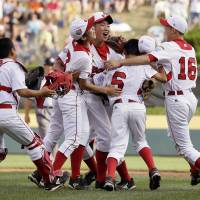 On top of the world: The Japanese team celebrates after winning the Little League World Series on Sunday in South Williamsport, Pennsylvania. | AP
