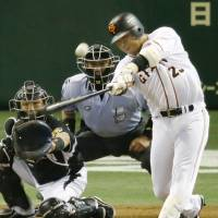 Work of art: Giants slugger Shuichi Murata belts a two-run home run in the first inning against the Tigers on Tuesday at Tokyo Dome. | KYODO