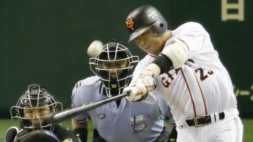 Work of art: Giants slugger Shuichi Murata belts a two-run home run in the first inning against the Tigers on Tuesday at Tokyo Dome.