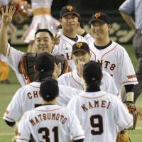 Magical: Giants players celebrate after their win over the Tigers on Wednesday at Tokyo Dome. The Kyojin have a magic number of 24 for clinching the Central League pennant. | KYODO