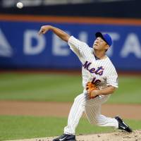 Erratic: New York starter Daisuke Matsuzaka fires a pitch against Philadelphia in the first inning on Wednesday night. | AP