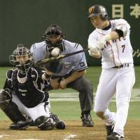 Thursday hero: The Giants' Hisayoshi Chono hits a game-winning home run in the 10th inning against the Tigers on Thursday at Tokyo Dome. Yomiuri beat Hanshin 3-2. | KYODO