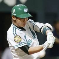Key moment: The Hawks' Kenta Imamiya strokes a bases-clearing triple in the sixth inning against the Eagles on Saturday. Fukuoka Softbank topped Tohoku Rakuten 9-2. | KYODO