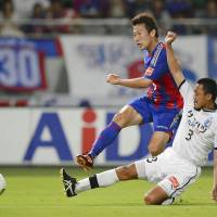 Rising force: FC Tokyo's Kazuma Watanabe (left) is leading the J. League with a career-high 14 goals this season. | KYODO