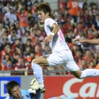 Man of the moment: Cerezo Osaka striker Yoichiro Kakitani scores his second goal of the game in Saturday's 3-0 win over Omiya Ardija. | KYODO