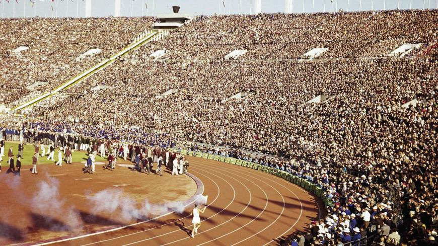Majestic moment: Yoshinori Sakai, who was born on the day of the atomic bombing in Hiroshima on Aug. 6, 1945, runs with the Olympic torch at the Opening Ceremony of the 1964 Tokyo Games at National Stadium.